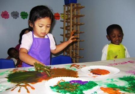 Two young children participating in an art class