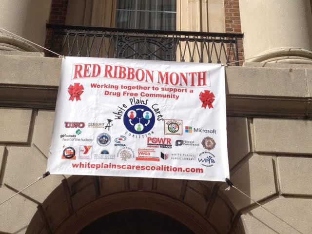 red ribbon white plains cares coalition banner